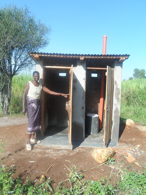Finter is opening the two doors of bathroom and latrine.