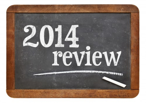 2014 review - year summary concept on a vintage slate blackboard
