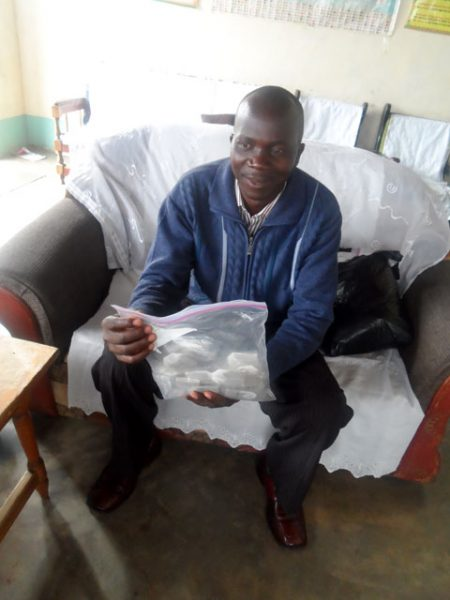 The pastor for the new church. He is holding a bag of Bible verse tea bags from LT.