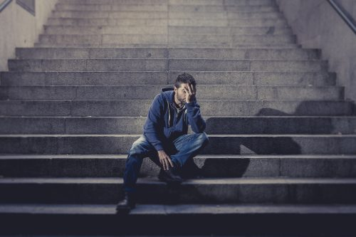 Young Man Lost In Depression Sitting On Ground Street Concrete S