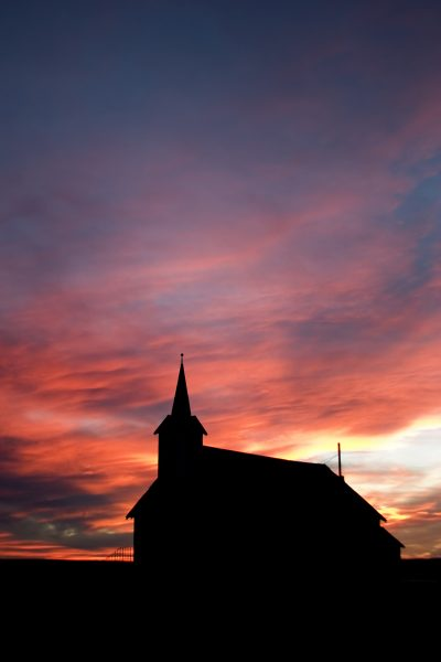 Church on the prairie landscape during sunset