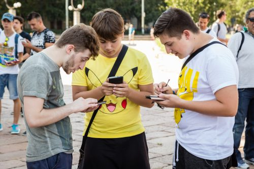 bigstockphoto.com | Young people playing Pokemon Go.