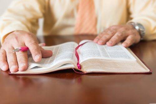 pastor studying Bible in christian college